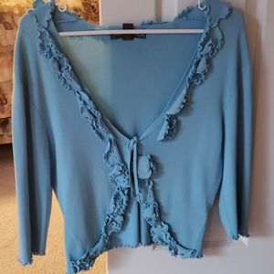 Flowered cardigans in pink and blue